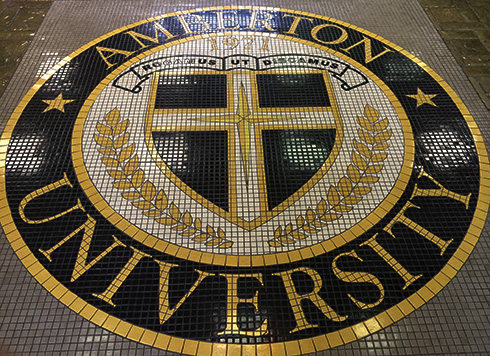 Amberton logo tiled on the floor of the lobby.