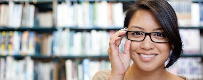 Student smiling in the Amberton library